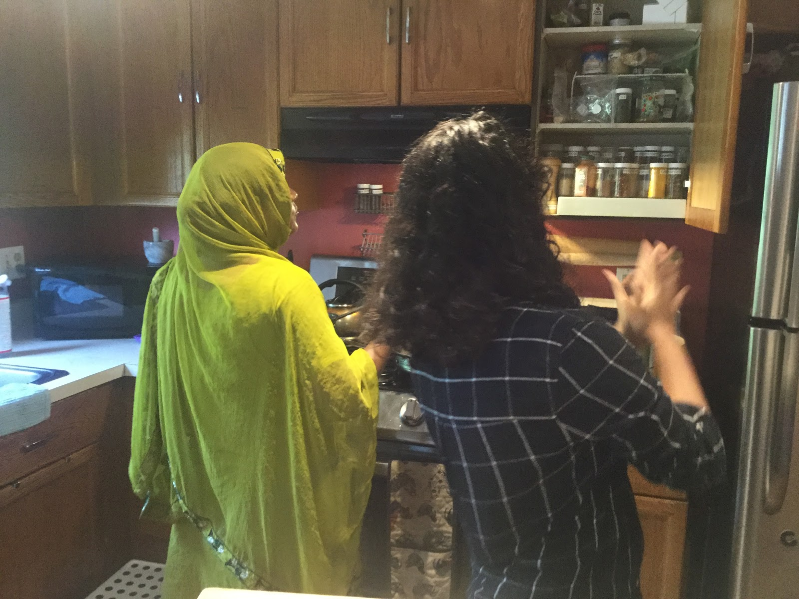 Aklima shows me how to properly cook her Bangladeshi squash
